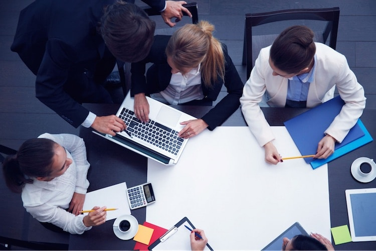 accounting professionals working around table