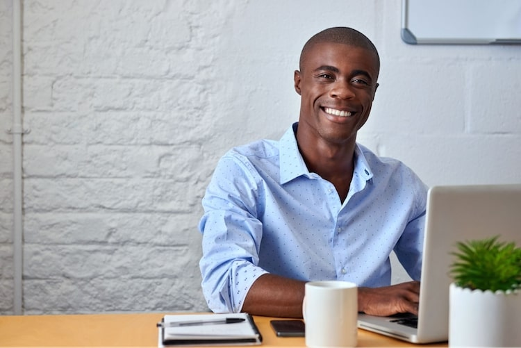 smiling business professional sitting at desk