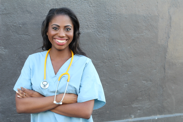 smiling nursing student in scrubs
