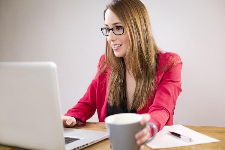 woman analyzing data using a laptop