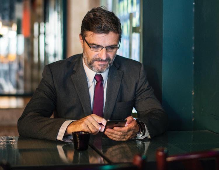CFO in suit using his phone