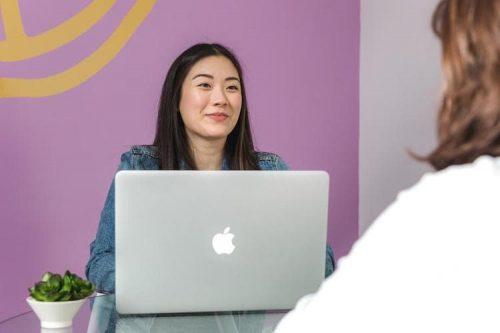 meeting between two ladies at desk
