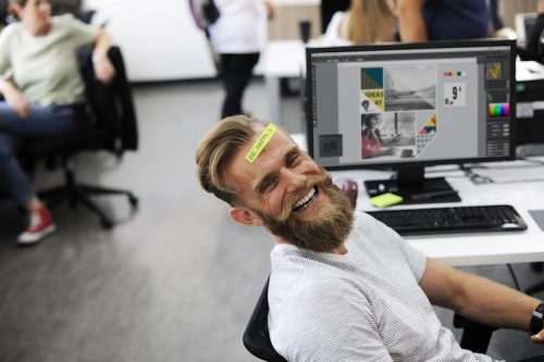 man-smiling-at-work