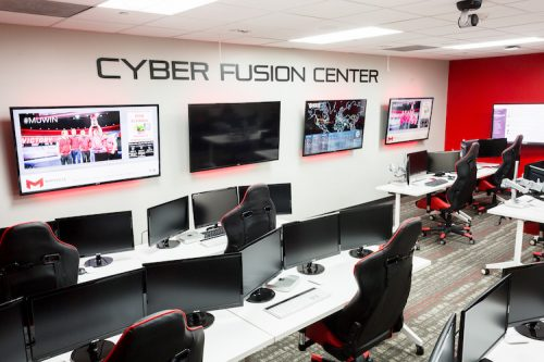 maryville universities cyber fusion center with multiple desks with computers and monitors