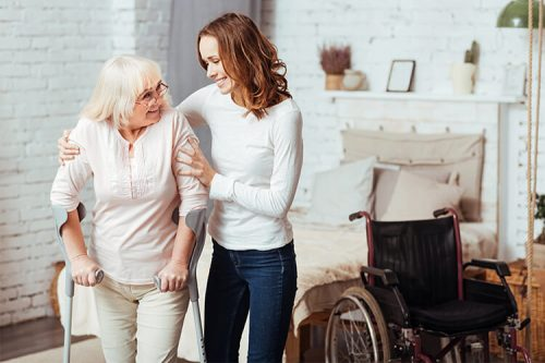Care worker helping an elderly woman