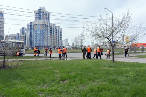 Probationers clean up litter in the city for community service.