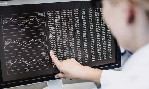 A data scientist analyzes metrics on a data chart.