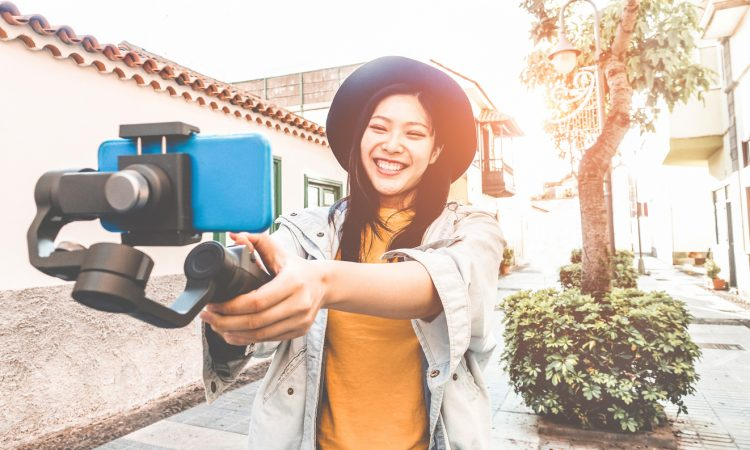 Female online influencer making a selfie viral video