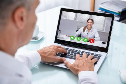 A patient has a video therapy session with his mental health practitioner.
