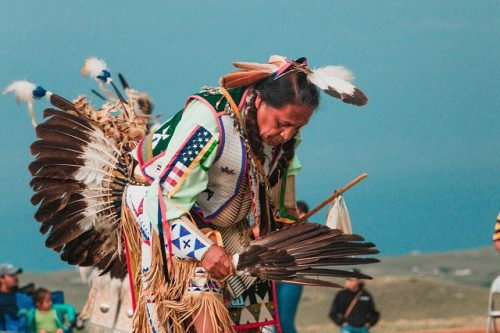 Native American man dancing in traditional garb