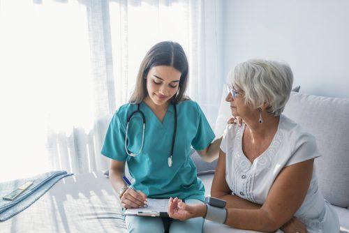 Nurse charts down a patient's vitals.