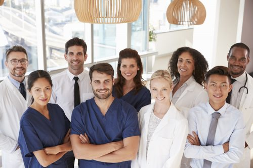 Nurse managers and charge nurses pose in a group.