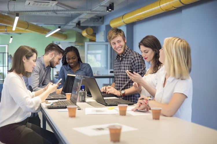 Social media strategists brainstorm social campaign ideas.