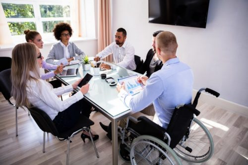 A hospital administrator leads a meeting.