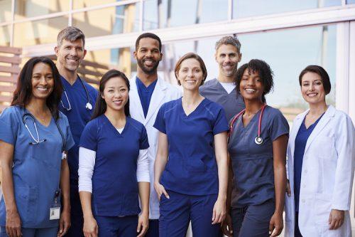 Group of nurses pose together.