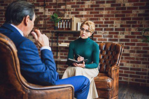 A psychologist interviews a client.