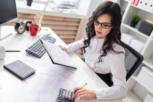 An accountant prepares a financial report.