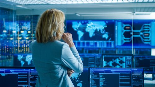 CIA agent analyzes information in a system control room.