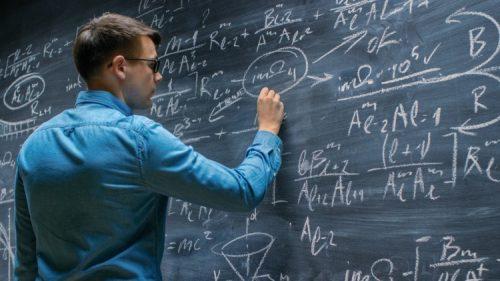 A mathematician solves an equation.