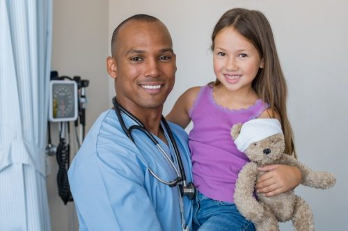 A pediatric nurse practitioner with a patient.