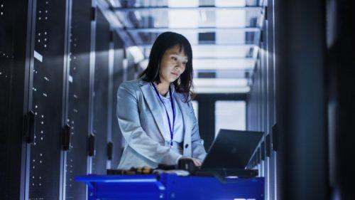 Cybersecurity engineer in a server room.