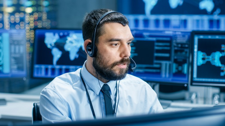 Cyber security professional at the controls