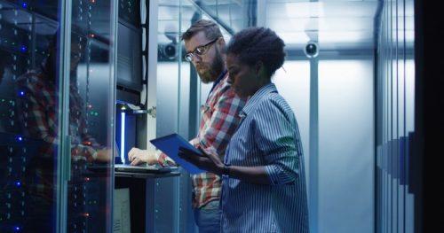 Computer scientists setting server hardware.