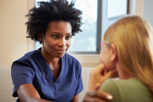 A psychiatric mental health nurse practitioner meets with a patient