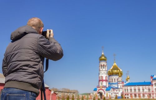 A-foreign-correspondent-like-this-photojournalist-with-a-camera-reports-on-international-events-in intriguing-locales.