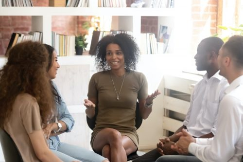 A multicultural counseling specialist meets with her group.
