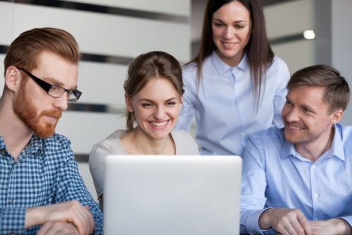 A media planner reviews content with her team.