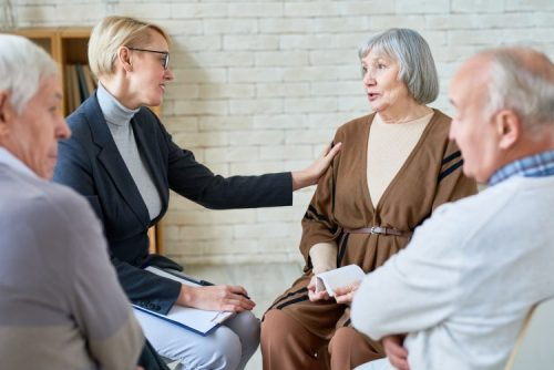 Social services worker meets with clients.