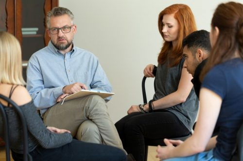 A rehab counselor works with clients.