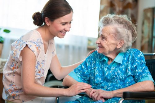 A nurse helps an assisted living home