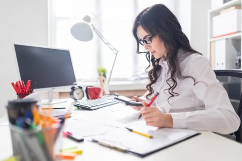 An accountant works at her desk.