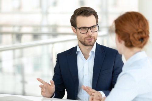 An account executive meets with a client.