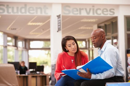 A college department chair meets with a student.