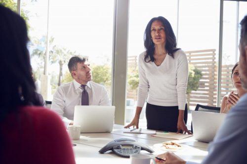 A CFO leads a team meeting.