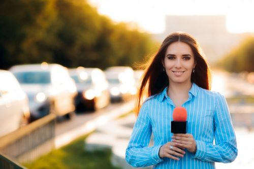 A reporter broadcasts from the city.