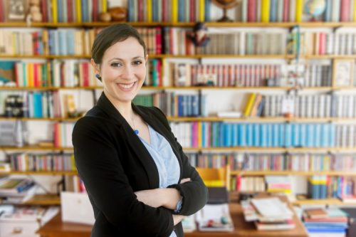 A sociologist conducts research in the library.