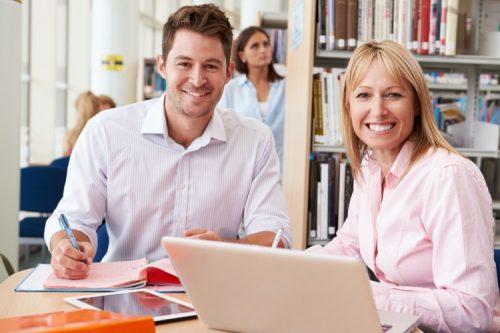 A department head assists a student.