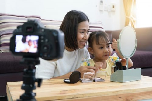 A mompreneur and her daughter work on a project.