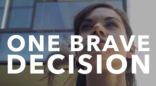 "Woman looking up with ""One Brave Decision"" text"
