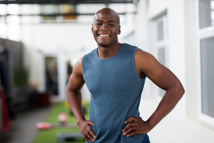 A personal trainer works at his gym.