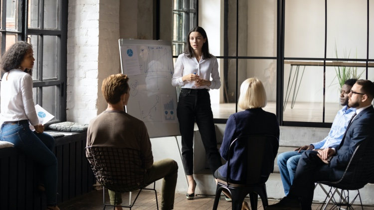 A business manager leads a team meeting
