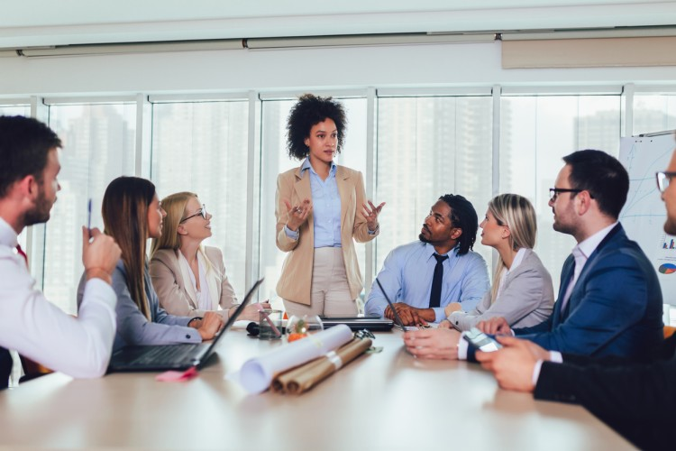 A manager leads a meeting of her colleagues.