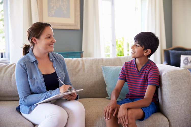 A child welfare social worker meets with her young client.