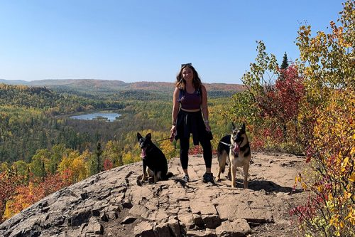 Lexy Vreeland on a hike with her two dogs.