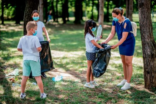 volunteers picking up trash in a park