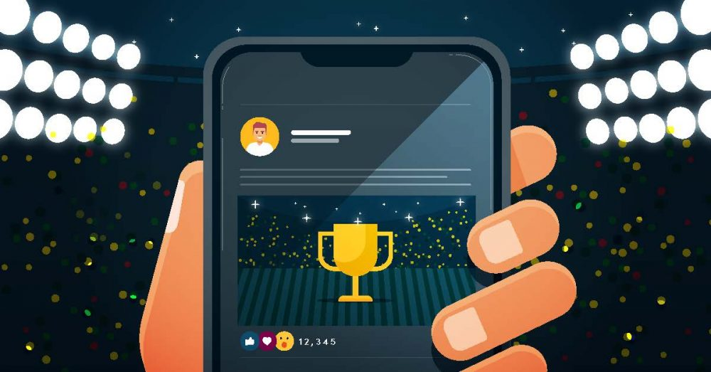 A hand holding a smartphone displaying a trophy